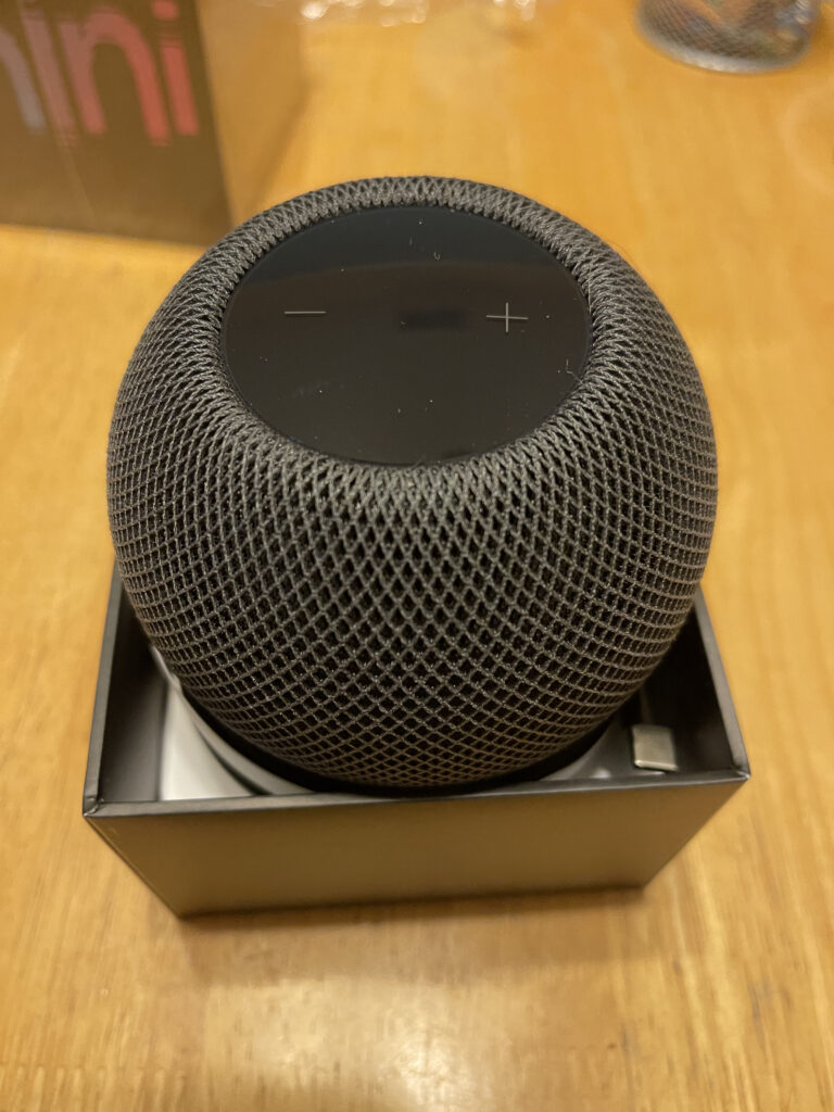 HomePod mini in its box.