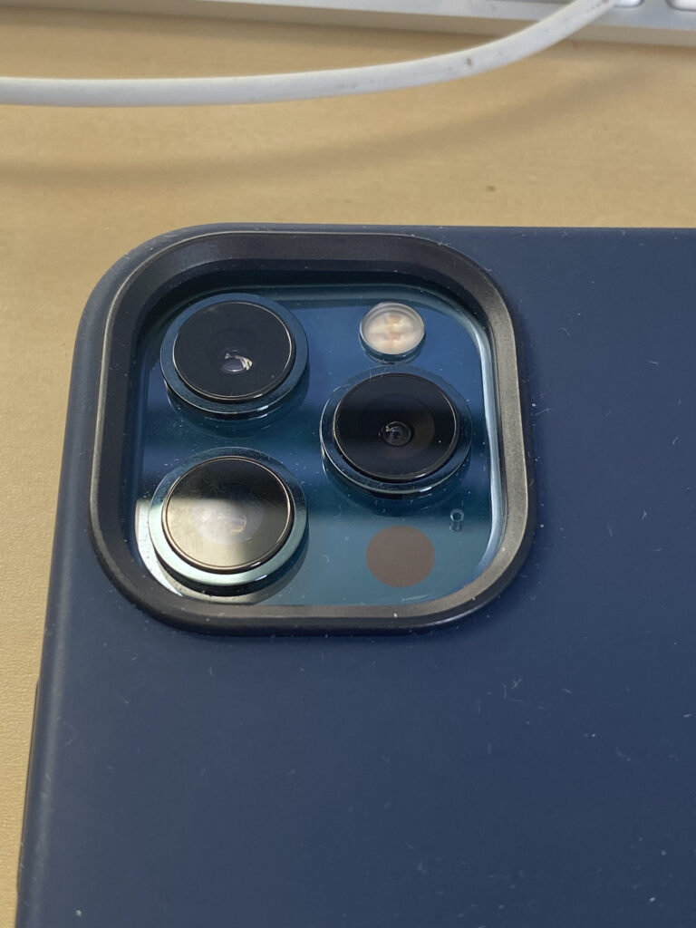 iPhone 12 Pro Max in the Apple Silicon Case with focusing on the Camera lenses.