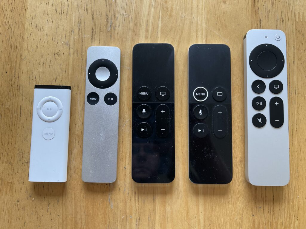 Each of the remotes included with each Apple TV oldest on the left and newest on the right.