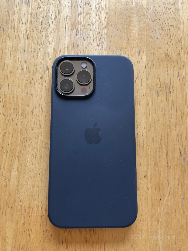 iPhone 13 Pro Max with a Midnight Case that looks like it is blue.