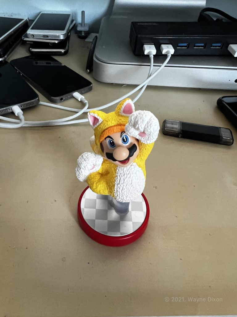 """Photo of Mario Figurine using """"Rich Contrast"""" Photographic Style"""