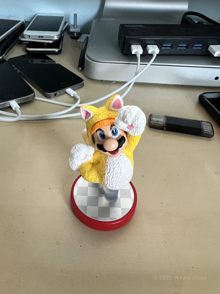 "Photo of Mario Figurine using ""Warm"" Photographic Style"